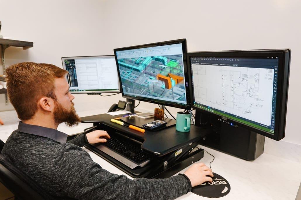 RWB employee at computer working on a building information model (BIM)