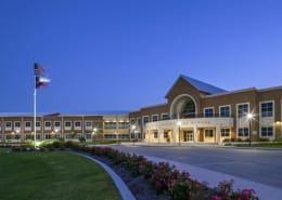 An image at dusk of Midlothian Heritage High School